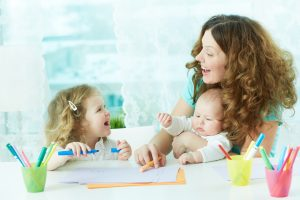 Babysitter Drawing with Two Children