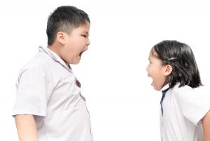 Brother and sister shouting before tattling to their mother