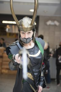 "Man in Loki Costume looking at camera ""Your God might not exist if..."" post"