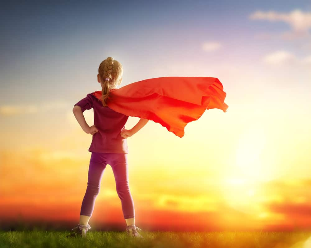 Girl stands with superhero cape as she realizes she can solve her own problems