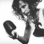 Boxer girl exercise with boxing gloves. Reading to Gain a Victory with these 5 Things because she has been feeling defeated