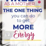 """A mom stands in her kitchen wearing a white robe, yawning while she holds her coffee. Text overlay """"Tired as a Mother? The One thing you can do to get more energy"""" 