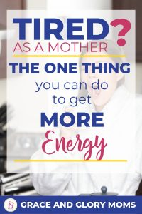 "A mom stands in her kitchen wearing a white robe, yawning while she holds her coffee. Text overlay ""Tired as a Mother? The One thing you can do to get more energy"" 